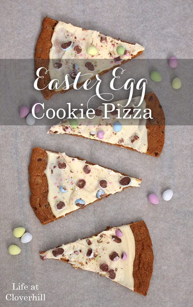 This Easter Egg Cookie Pizza recipe is a quick last minute dessert idea the kids can help you make using candy coated chocolate eggs.