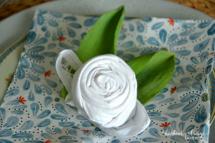 Spring tablescape with flower folded napkin from Kenarry Ideas for the Home and Rita Joy from Harbour Breeze Home
