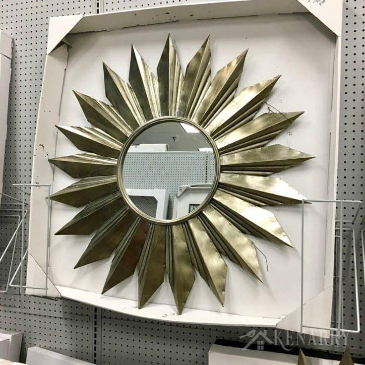 Large starburst mirror as possible decor for new sunroom addition on a renovated cottage.