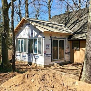 In progress photo of new sunroom addition on a renovated cottage