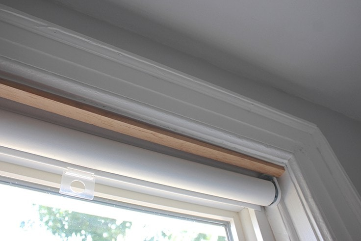 The wood pieces fit snuggly inside the window frame.