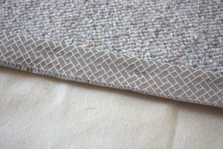Fabric stapled to the wood piece.