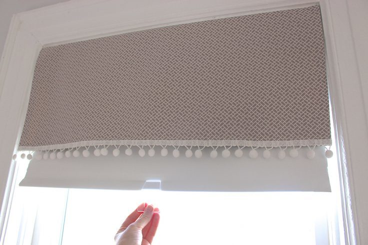 The roller blind behind the valance