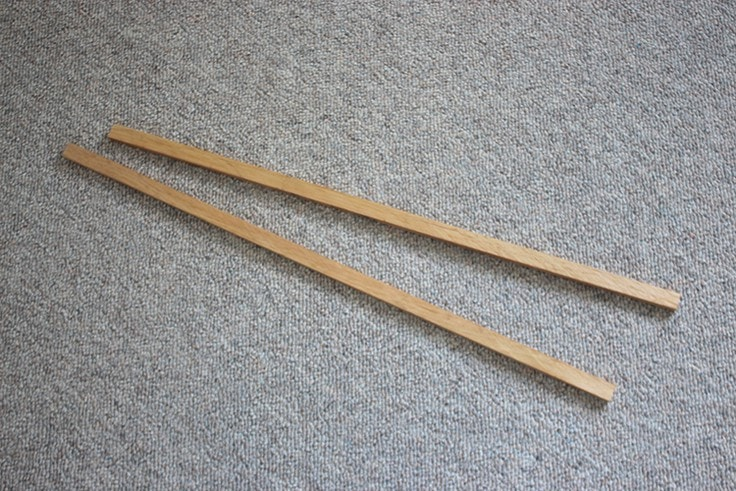 2 strips of wood.
