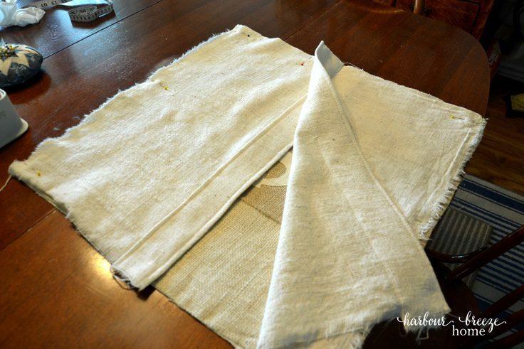 Putting together a DIY burlap pillow