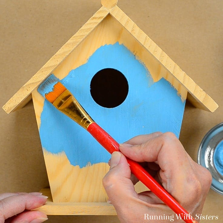 Painting the front of a birdhouse ocean blue