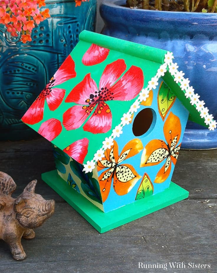 Floral birdhouse decoupage with fabric and Mod Podge.