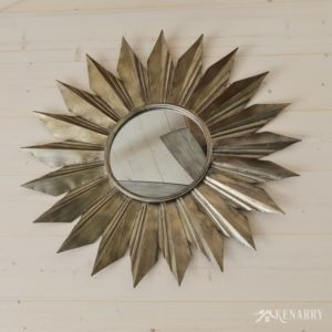 A large metal sunburst mirror on a shiplap wall in a cottage | industrial style | sunroom | shiplap walls | plank wall | whitewashed pine wood walls | home decor | home ideas | farmhouse style