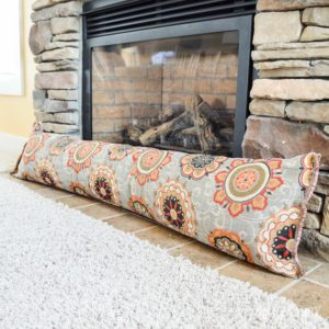 Keep cold air from coming through your fireplace vent when you make a DIY fireplace draft stopper using this simple sewing tutorial and upholstery fabric. This easy DIY idea will help save heating costs this winter. draft stopper | draft protector | draft excluder | door draft blocker