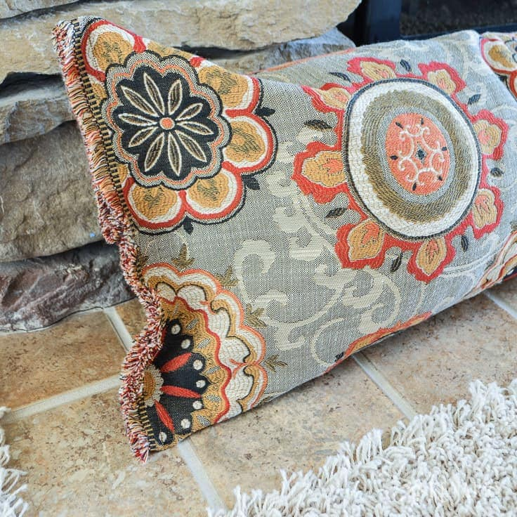 A fireplace draft stopper helps save heating costs and blocks cold air in the winter. You can easily learn how to make a draft blocker with this simple sewing tutorial. draft stopper | draft protector | draft excluder | door draft blocker