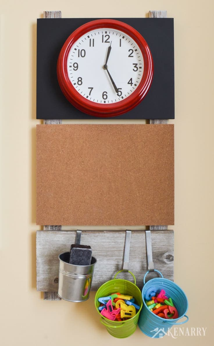 A large bright red clock is useful playroom wall decor to help children learn to tell time. This gallery wall or message board also includes a corkboard and storage containers for magnetic letters and a dry eraser.
