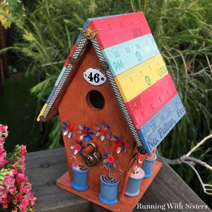 Make a fleastyle yardstick birdhouse. We'll show you how to distress the yardsticks and how to add flowers punched from cans. Great upcycle project!