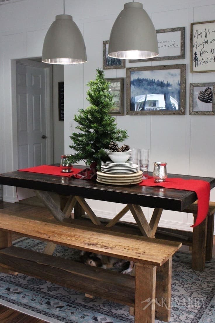 A Christmas tree on a red burlap table runner adds height and dramatic style to your holiday decor, especially on a farmhouse style table.