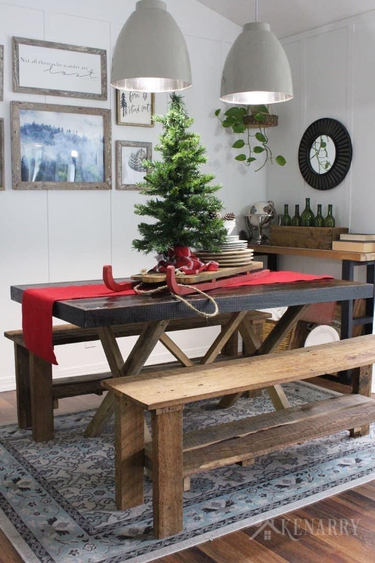 A tree with a sled on a red burlap table runner adds dramatic style to your Christmas home decor, especially on a farmhouse style table. It's beautiful for holiday decorating.