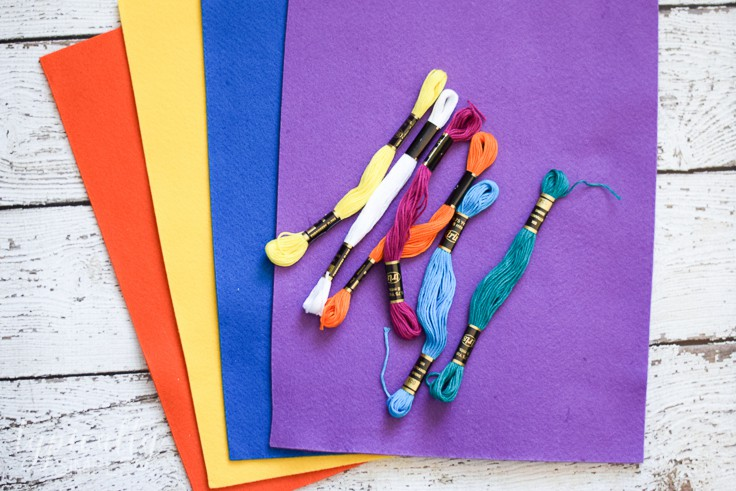 Colorful sheets of felt and assorted colors of thread. These can all be used to make corner bookmarks.