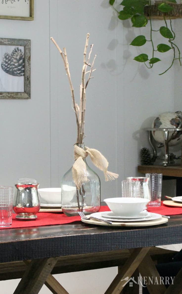 Put long sticks in a large clear glass vase as a centerpiece this holiday season. As Thanksgiving table decor, this simple stylish centerpiece adds just the right amount of height and drama to your dinner table. Throw in a red burlap table runner for added texture.