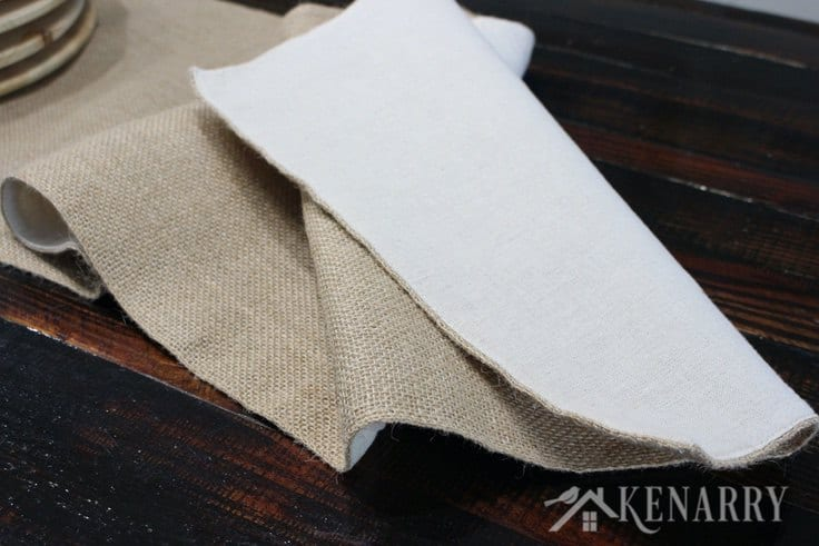 This natural burlap table runner is fabric lined with sewn hemmed edges for high quality style. It adds rustic charm to your Thanksgiving table decor or any holiday dinner.