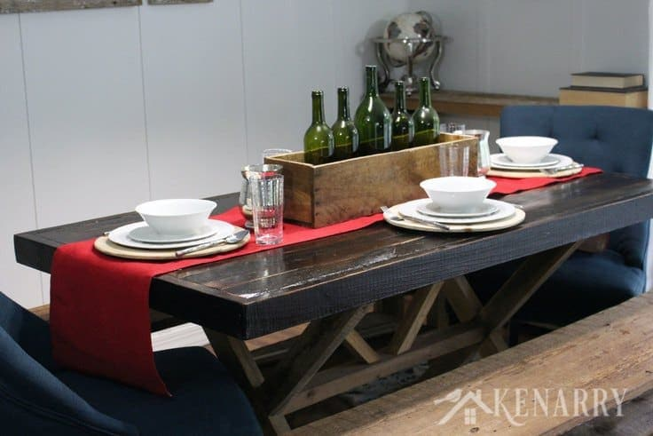 Use simple white dishes for holiday dinners. Add a wood planter box filled with empty wine bottles as your centerpiece on a red burlap table runner for your Thanksgiving table decor if you love farmhouse style decorating in your home.
