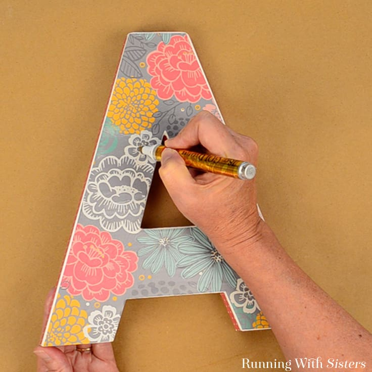 Decoupage a letter to give as a handmade gift! We'll show you how to decorate a craft store letter with scrapbook paper and Mod Podge.