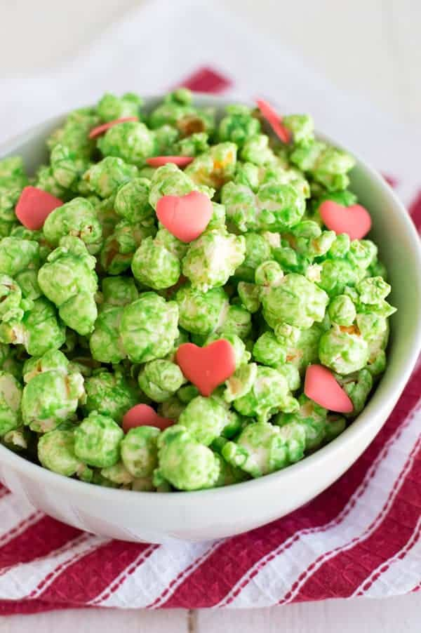 Grinch Popcorn – Cook. Craft. Love. - 14 Easy Dessert Recipes and Christmas Potluck Ideas featured on Kenarry.com