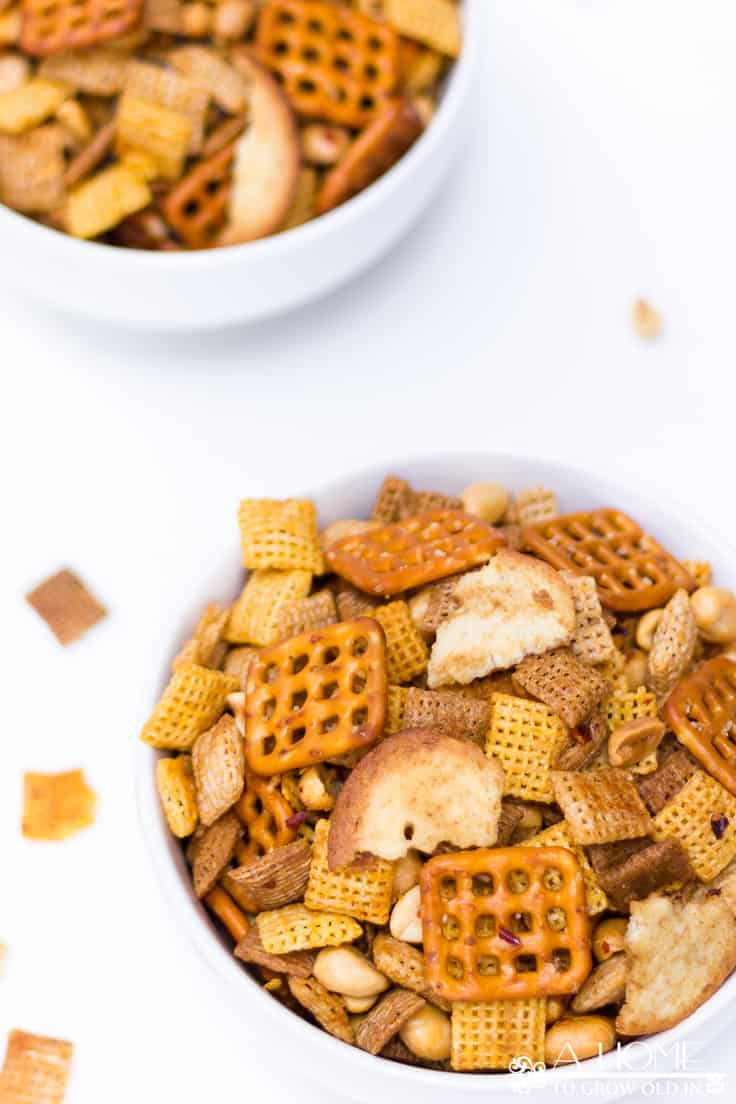 This spicy Sriracha Chex mix is the perfect appetizer or snack recipe for your next holiday get-together!