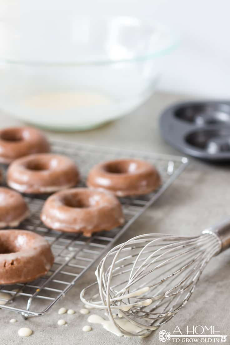 These delicious baked chocolate glazed donuts are a lightened up version of the fried variety but your sweet tooth will never know it.