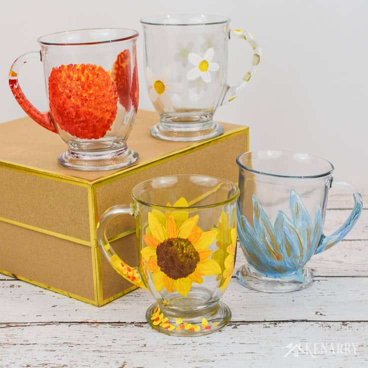 These four DIY coffee mugs each have a different flower design hand painted on the side using gloss enamel craft paints. It's easy to do with this tutorial.