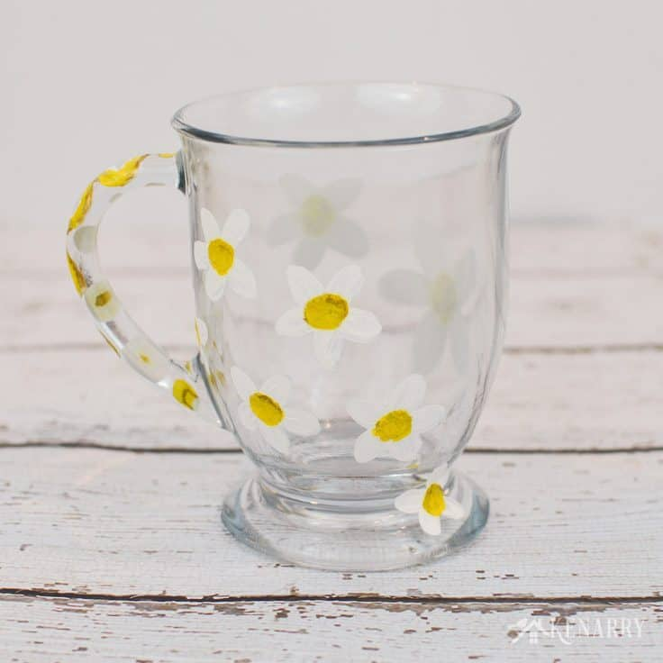 I love the simple daisy pattern on the side of this coffee cup. Learn how to paint DIY coffee mugs in this easy craft tutorial.