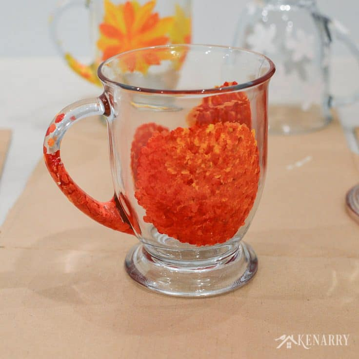 Layer dots of red, orange and yellow gloss enamel paints to create beautiful flowers on the side of DIY coffee mugs. Learn how in this easy craft tutorial.