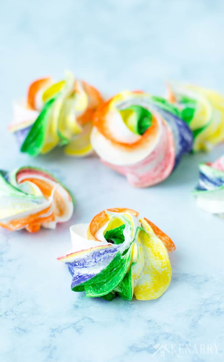 Ever tried making your own meringues. It's so easy! Use this recipe for Rainbow Meringues to make a fun and festive dessert for your next St. Patrick's Day party! They'd be the perfect treat for Mardi Gras or a birthday party too.