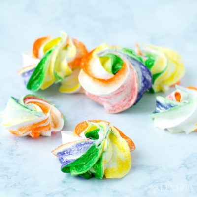 These simple and sweet Rainbow Meringues are a colorful, easy recipe idea for your next St. Patrick's Day party! They'd make the perfect treat for Mardi Gras or a birthday party too.