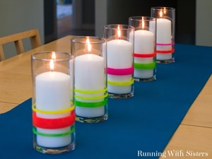 Turn dollar store vases into colorful candle holders using nail polish!