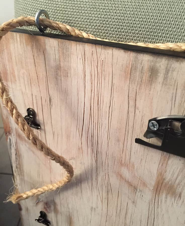 DIY distressed wood hanging organizer hung with twine