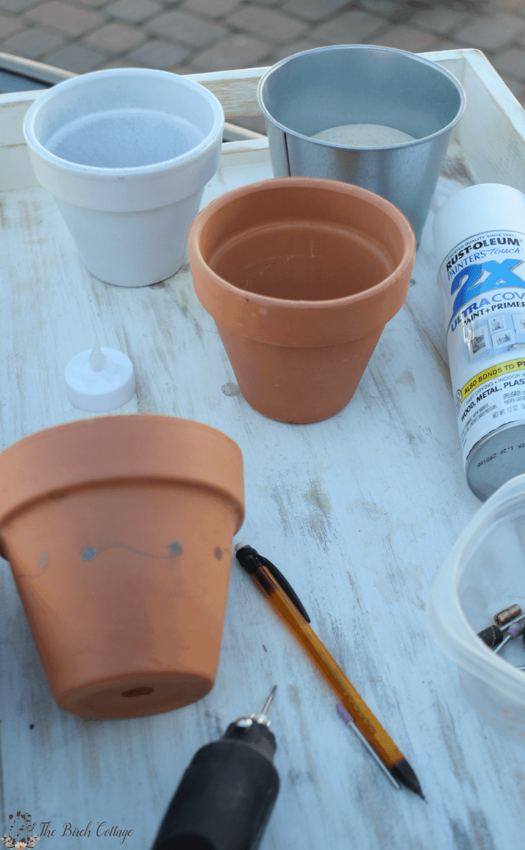 DIY Terra Cotta Pot Luminaries by The Birch Cottage