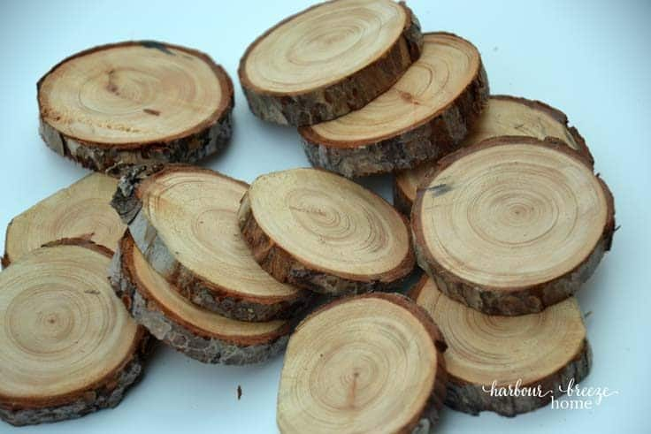 Pile of wood slices made out of branches sitting on a white table