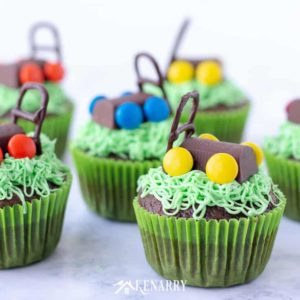 Use this tutorial to make delicious and fun Father's Day cupcakes with edible lawn mowers. This easy dessert idea uses a boxed cake mix and candy so anyone can learn to decorate and impress their dad! #fathersday #cupcakes