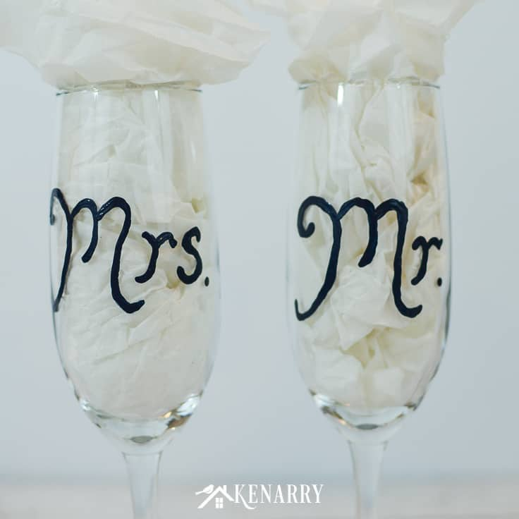 These Mr. and Mrs. toasting glasses are an easy DIY gift for the bride and groom, perfect for a bridal shower, wedding or anniversary. Learn how to paint champagne flutes. #weddinggifts #weddingideas #weddingreception #handpainted