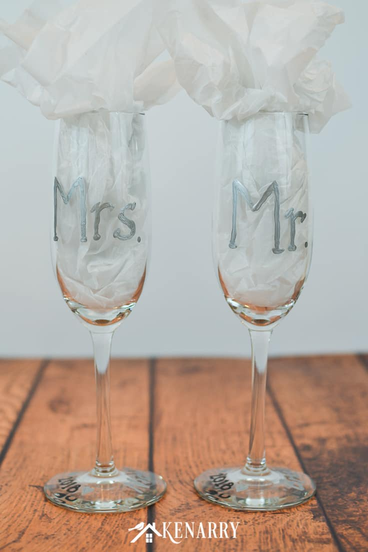 Got a friend who's getting married? Surprise her with personalized hand painted champagne glasses. These Mr. and Mrs. toasting glasses are an easy DIY gift for the bride and groom. Champagne flutes are perfect for a bridal shower, wedding or anniversary. #weddinggifts #weddingideas #weddingreception #handpainted