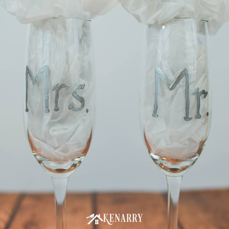Learn how to make personalized hand painted toasting glasses. These Mr. and Mrs. champagne flutes are an easy DIY gift for the bride and groom, perfect for a bridal shower, wedding or anniversary. #weddinggifts #weddingideas #weddingreception #handpainted