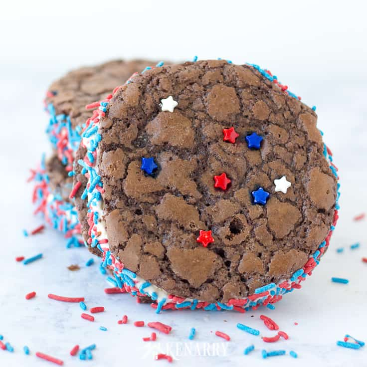 Patriotic brownie cookie ice cream sandwiches with red and blue sprinkles