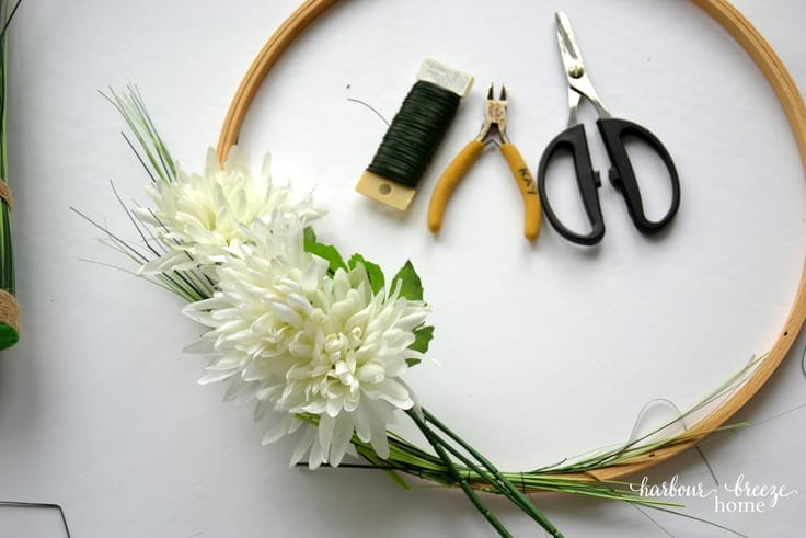 White flowers on an embroidery hoop wreath