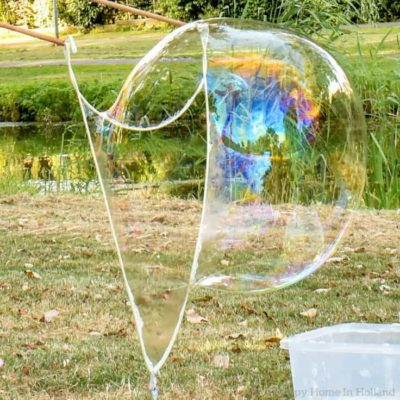 Learn how to create super fun giant bubbles with a couple of sticks and some string!