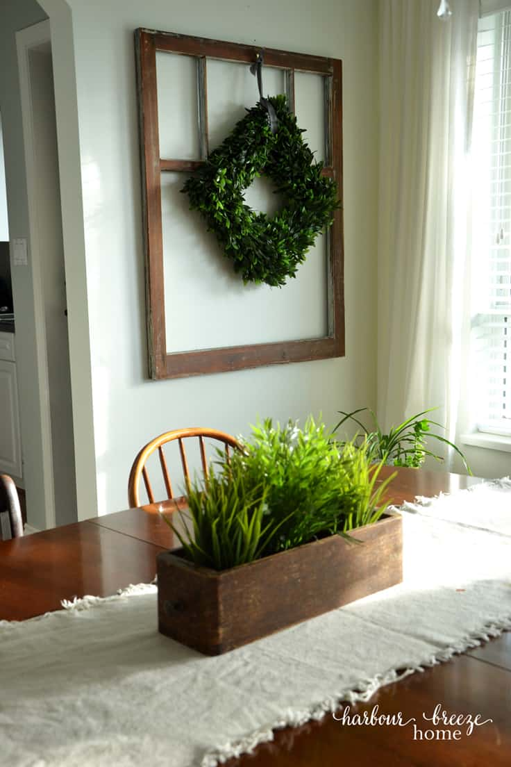 Antique Window with boxwood wreath hung in front of it