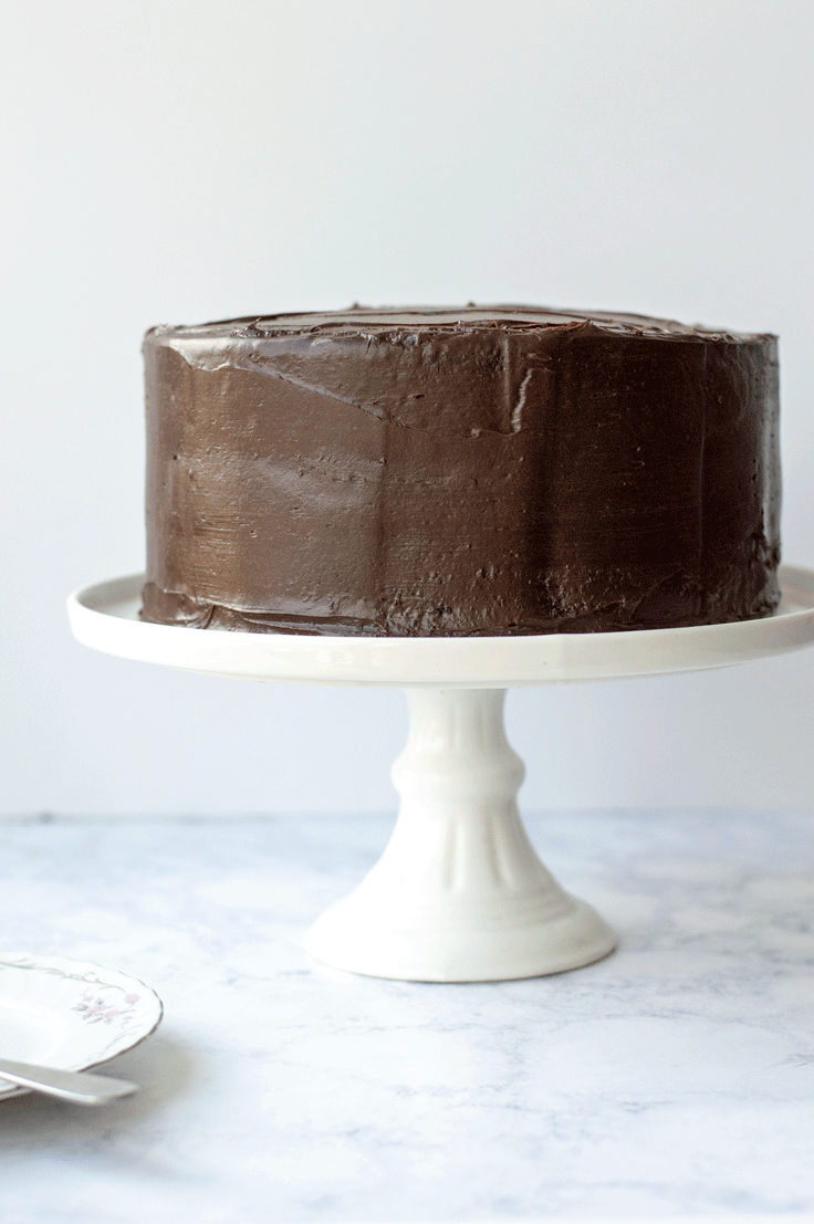 The ultimate chocolate cake recipe is something that you always want to have in your back pocket. But this delicious chocolate cake is from a doctored chocolate cake mix. And your friends or guests will never be able to tell! #dessert #recipe #chocolate #cake #chocolatecake