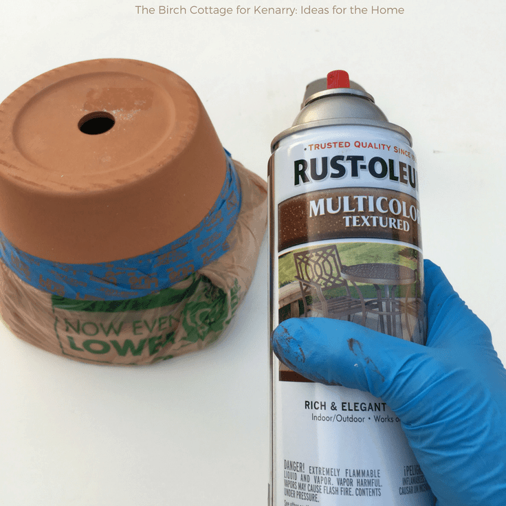 Using Rust-Oleum Spray paint to decorate a clay flower pot