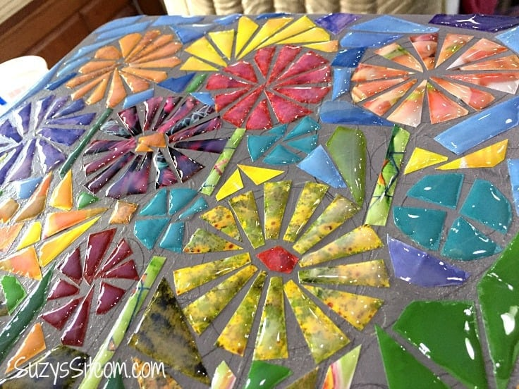 Looking for creative projects or ideas that are perfect for kids and adults? Turn a stool into recycled magazine art. Learn how to make a faux DIY ceramic mosaic with paper.  A great use for pictures from old magazines! #crafts #diy #mosiac #homedecor #upcycle #recycle #kenarry