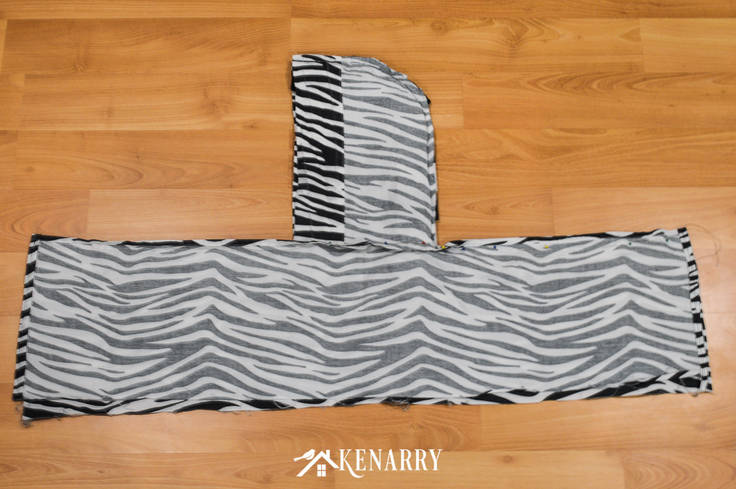 Use black and white zebra print fabric to create a vest that a child can wear as a kids zebra costume for Halloween or to play dress-up as a jungle animal.