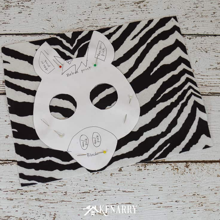 Use zebra print felt to make an easy zebra mask for a kids zebra costume for Halloween or animal dress-up.