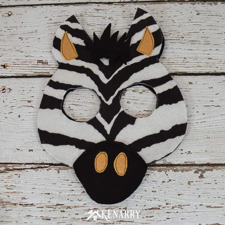 Use zebra striped felt and other felt fabric to create a diy zebra head mask for Halloween. This tutorial includes a free printable jungle mask template.