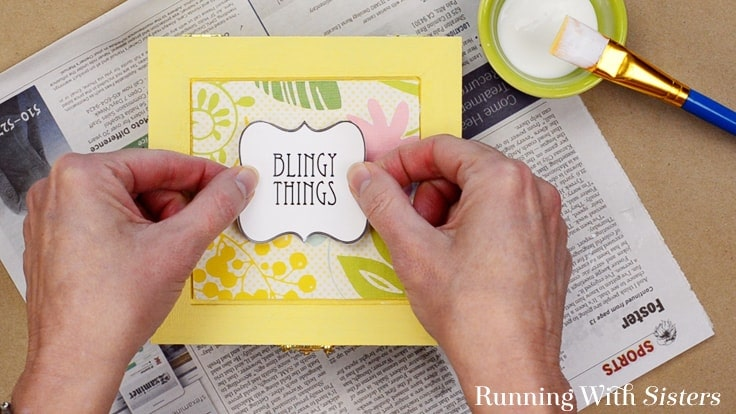 "Make an Easy Jewelry Box with a cute label. We'll show you how to decoupage the box with scrapbook paper and a cute downloadable ""Blingy Things"" label."